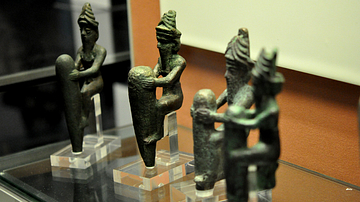 Copper alloy foundation figurines with pegs representing Gods
