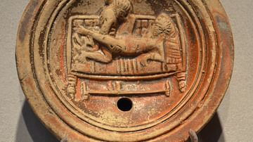 Roman oil lamp with erotic scene