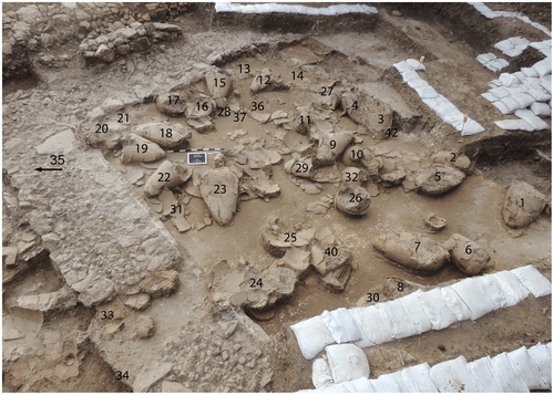 2013 image of labelled wine jars in first Tel Kabri wine cellar towards the southeast (by Eric H. Cline, CC BY-SA)